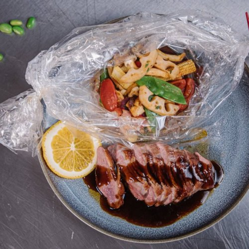 Duck Breast in Teriyaki Orange Sauce with Vegetable Parcel